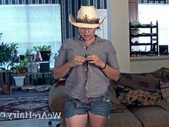 Cowgirl Lucy Dutch strips and enjoys her body