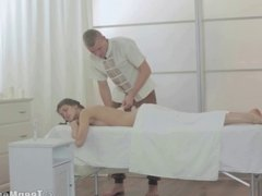 Lovely cutie fucked on the massage table