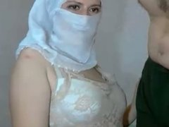 Head scarf girl blows guys cock, shows tits