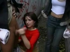 Pervert girls jerking a boy outside