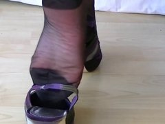 Sexy footplay in black rht's and purple slingbacks Part 2