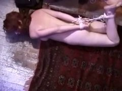 Redhead in the floor bound and gagged