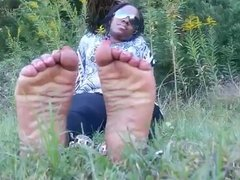 Big Black Boong Feet of an Australoid Abo Woman in the Grass