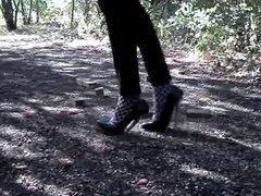 Walking and bending 6 inch silver heels in hoods
