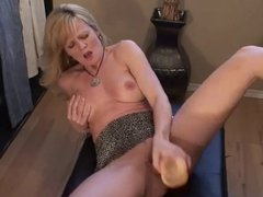 Skinny blonde MILF fucks herself and squirts