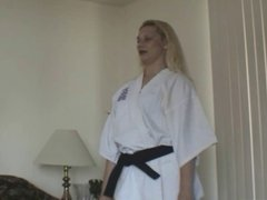 Female Black Belt demos how to break his balls