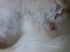 Male nipples saline injection during scrotal infusion play