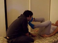 Asian girl gets her socks and feet worshipped