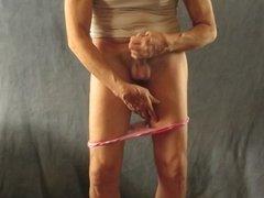 Pantyboy pulls his panties down to masturbate.