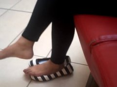Candid Girl taking off shoes and showing her barefeet