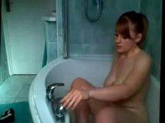 Busty teen masturbates in bathtub