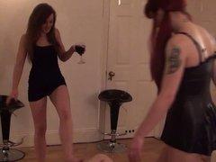 2 babes kicking and trampling slave