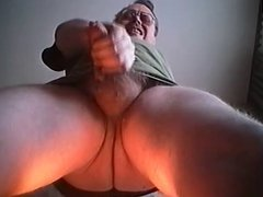 man in glasses wanking