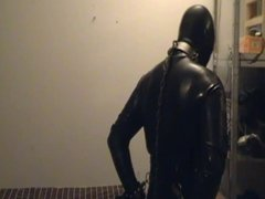 Young rubber slave having his breakfast