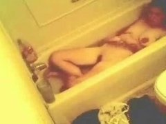 My mom masturbating in bath tube 1. Hidden cam