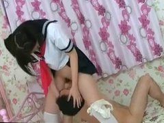Asian face fucking  and riding boy's face