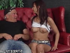 Brunette girl smoking a cigarette during SteetFlirts casting