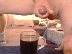 Slow Motion Cumshoot in a glass Coffee