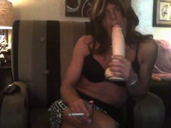Crossdresser smoking ad sucking a dildo