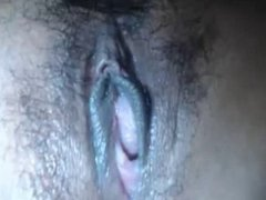 Up-close young girl rubbing hairy pussy
