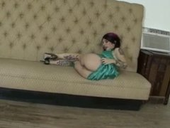 Horny tattoed MILF rubs her pussy and toys her ass