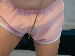 Self caning in pink shorts