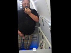 Chub stroking in an airplane bathroom