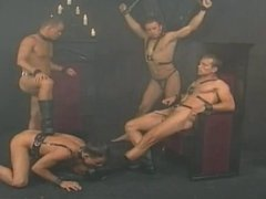 Group leather gays in darkroom