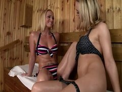 Two blond girls in the sauna