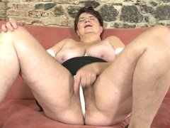 Mature mother playing with her hairy pussy