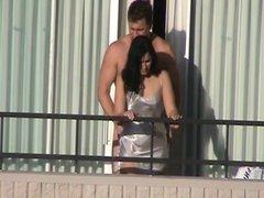 a coach fucks his wife out the balcon