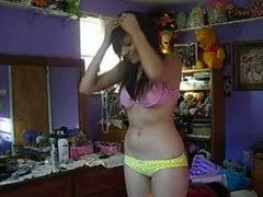 Cute amateur records herself getting naked on video
