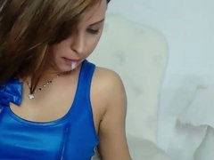 Sexy girl spits on her shiny blue top