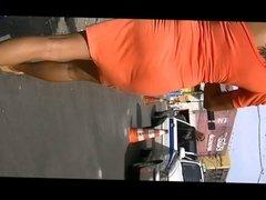 Brunette in paprika dress