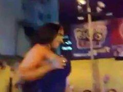 Brazilian brunette flashes big boobies in public
