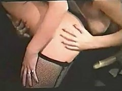 Lesbians with silk scarf playing with strap-on
