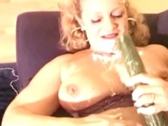 mature blonde and a cucumber