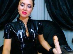 Brunette MILF spits on her black latex suit