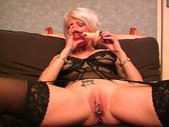 Dirty mature with pierced pussy lips get fucked