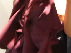 Woman in stockings measures the dress fitting 2