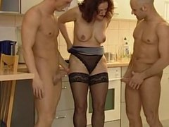 Horny milf and two guys fucking in the kitchen