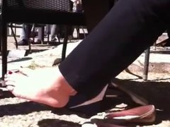 Candid Feet flats outside cafe