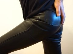 crossdresser in tight shiny leather jeans ass