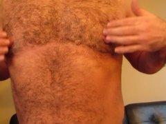 Tugging on my big, man nipples