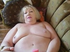 Blond granny masturbate on the couch