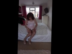 Sindy caresses her pleated pink slip