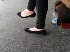 Beautiful feet in black flats