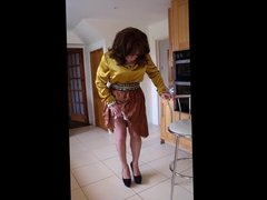Sindy lifts up and swishes her skirt