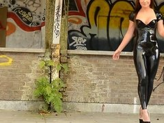 Julie Skyhigh teasing in latex Catsuit and platform heels