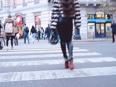 most sexy girl in soft leather legging walking across street